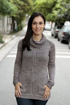 This sweater will soon become a staple in anyone's wardrobe with its classic lines and casual beauty. The cowl neck is detachable, giving you options for cooler or milder days. The handy front pockets