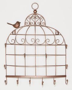 Keep your jewelry at bay with this fab organizer! Get it here: http://www.bhg.com/shop/world-market-bird-cage-wall-jewelry-holder-p50057c1882a75e55847c842a.html?mz=a