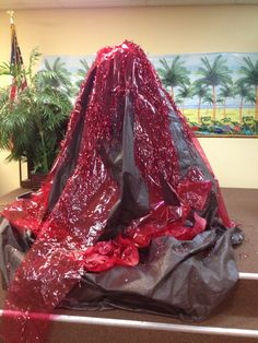 Volcano by Shelley, brown tarp red cellophane  & add red tinsel for sparkle
