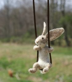 Cute little stuffed bunny on a swing