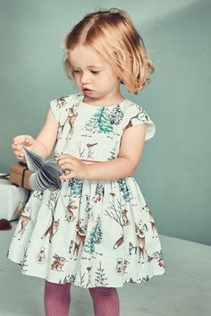 Up the cute factor for your little fashionista with this ecru deer print prom dress. You're sure to fall in love with this statement piece! Beach Wear Dresses, Casual Dresses, Girls Dresses, Flower Girl Dresses, Prom Dresses, Little Fashionista, Little Girl Outfits, Little Girl Fashion, Girls Winter Fashion