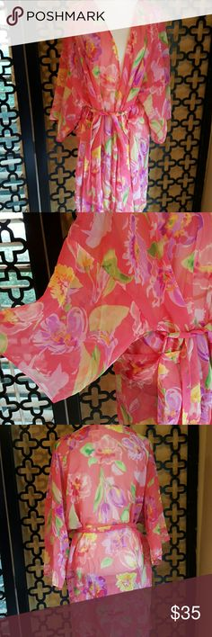 VINTAGE GLORIA VANDERBILT CORALS FLORAL ROBE EUC, NO FLAWS. Love this robe, yes, has belt. Size 18/20. Fits 50 up inches around the bust. Length is 37 inches. Pretty colors of coeal, purples, yellow and white. Circa 70s. Vintage Intimates & Sleepwear Robes