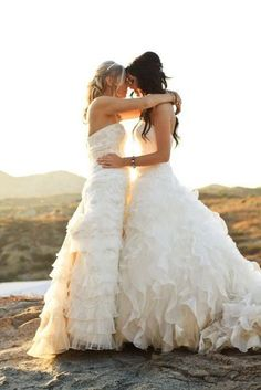 Awww. They both have on wedding dresses, that's adorable. I love it