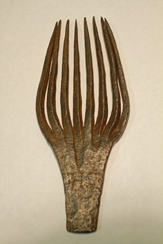 "Flax Ripple - Wrought Iron. Signed/Incised "".H.S."". American. Circa Early to Mid-18th Century. 10"" x 4-1/8"" x 7/16"". From the Personal Collection of Jonathan B. Pons."