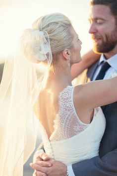 Classic updo with an elbow-length veil | Photo by Jennifer Fujikawa