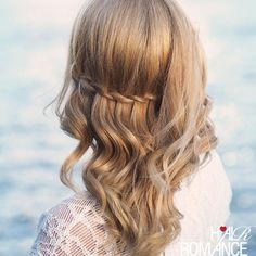 This mix of loose waves and a waterfall braid is anything but basic.