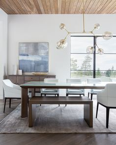 Furnishings in the dining room were created to participate with the views, not distract from them. Click on the link in our bio to see more of this striking Utah home. - Photos by: Scot Zimmerman Architect: Warren Lloyd of @lloydarchitects Interior designer: @AnneMarieBarton