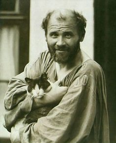 Gustav Klimt and his cat. 1862 - 1918. Born Baumgarten, Austria. Painter. Symbolism, Art Nouveau. an Austrian symbolist painter and one of the most prominent members of the Vienna Secession movement. Klimt is noted for his paintings, murals, sketches, and other art objects.