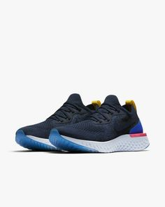 8b64a8af2d12 Nike Epic React Flyknit Womens Running Shoe College Navy Racer Blue Pink  Blast College Navy AQ0070-400