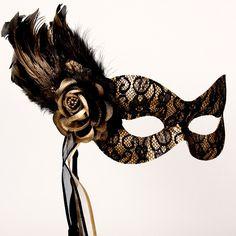 Beautiful Black and Gold Lace Masquerade Masked Ball Stick Mask. $48.99, via Etsy.