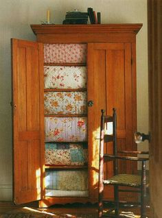 patchwork quilts in a gigantic, beautifully crafted armoire. Old Quilts, Vintage Quilts, Antique Quilts, Baby Quilts, Wabi Sabi, Table Farmhouse, Fresh Farmhouse, Vintage Farmhouse, Farmhouse Style
