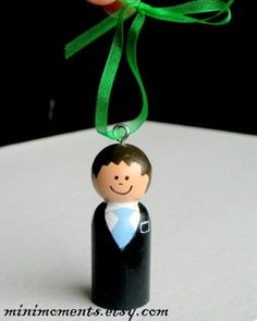 Missionary Christmas Ornament - can purchase these but would be very simple to make out of wooden pegs, paint, ribbon, and screw eyelets.
