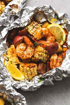 Easy, tasty shrimp boil dinners baked or grilled in foil with homemade seasoning, fresh lemon, and brown butter sauce. | lecremedelacrumb.com