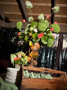 This floral arrangement is perfect for a rustic wedding!