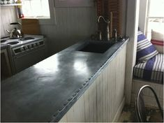 Galvanized metal countertops given the finish of old Parisian zinc. Metal Countertops, Kitchen Countertops, Kitchen Benchtops, Joanna Gaines, Fixer Upper, Outdoor Kitchen Bars, New Kitchen, Kitchen Ideas, Kitchen Redo