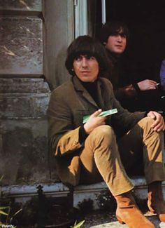 """George Harrison and John Lennon on the set of 'Help!"""" (1965)."""