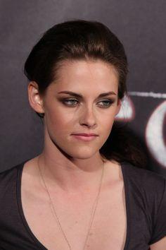 Kristen Stewarts loose low side ponytail hairstyle