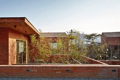 Image 13 of 31 from gallery of Fortress Brick House / Wise Architecture. Photograph by Roh Kyung Brick Architecture, Architecture Photo, Being A Landlord, The Neighbourhood, Scenery, Exterior, Cabin, Mansions, House Styles