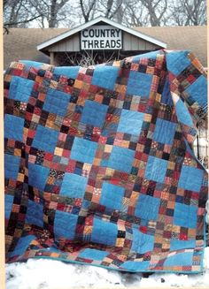 "A quilt made of materials you have on hand - blue jeans and scraps cut into squares. Make your free quilt any size. Ours measures 60"" x 80""."