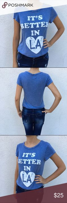 It's Better in LA tee NWT It's Better in LA tee. Features a vintage worn look. Made in USA. Vintage light blue. Short sleeve. 95%rayon 5%spandex. Available sizes: small, medium and Large. New with tags from my boutique. Tops Tees - Short Sleeve