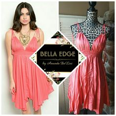 Coral babydoll dress ?100% VISCOSE. Elastic waistband, coral babydoll style dress. V-neckline and v-back. Ties at shoulders. Sizes small to large. Makes a cute summer dress or even a swim cover up. Bella Edge Boutique  Dresses