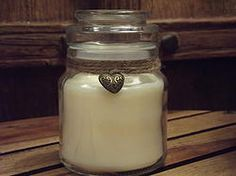 Soy wax scented candle in a classic glass jar with lid.