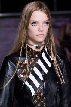 This season's braids—tight, streamlined and functional—are a major shift from the loose, bohemian ones that tend to pair well with airy white dresses and pop up at festivals, perhaps because this season's collections include more black leather and buttoned-up collars than ever before. At Louis Vuitton (left), thin, peek-a-boo braids added subtle texture (think of them as grown-up versions of the hair wraps we all got on vacation as kids), while Proenza Schouler, Céline and Public School…