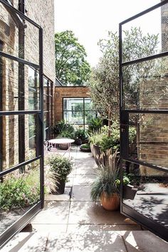 The ancient brick exterior grounds the home in its historic context, but the modern steel-framed windows and doors make the space feel current.
