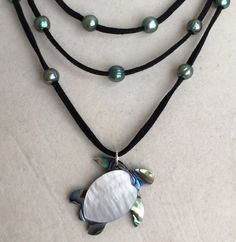 A personal favorite from my Etsy shop https://www.etsy.com/listing/519277065/sea-wanderer-mother-of-pearl-pendant