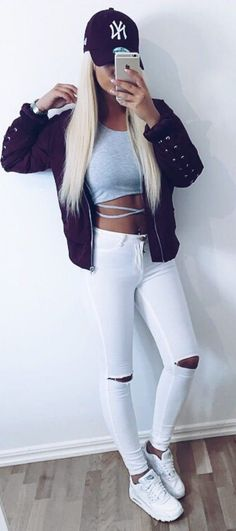 what to wear with a maroon bomber   hat + crop top + white ripped jeans +  sneakers cfa3abd011990