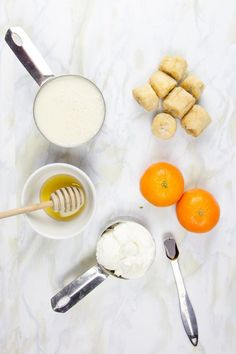 Orange Creamsicle Smoothie  To make it, blend together:  1 frozen banana 1 orange, peeled or 1 clementines, peeled 1/2 cup plain Greek yogurt 1/2 teaspoon vanilla extract 1 cup unsweetened milk (nut, soy, animal) Honey or maple syrup, to taste