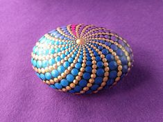 Hand painted Mandala Stone using acrylic paint and protected with Matt varnish.  Its a beautiful beach stone, almost perfectly rounded by nature.  This is one of a kind stone and is about 7,5 cm long.  Please leave me a message if you have any questions.  The stone is ready to ship within 1-3 business days using DHL with tracking number