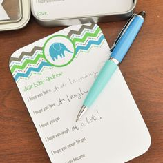 Baby Shower Activity Notes For Baby-To-Be with Personalized Keepsake Tin Set of 36. $23.50, via Etsy.
