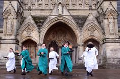 Feb. 5, 2013. Probationers from Salisbury Cathedral Choir flip pancakes in front of the west door at Salisbury Cathedral in Salisbury, England.