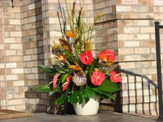 Mixture of fresh tropicals from Hawaii, Protea, Anthruim, Ginger, cigar tropical ect