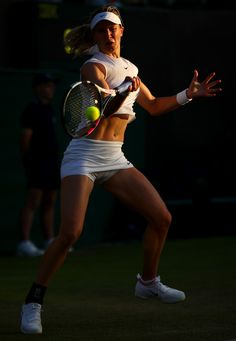 Eugenie Bouchard Photos Photos - Eugenie Bouchard of Canada plays a forehand during the Ladies Singles first round match against Carla Suarez Navarro of Spain on day one of the Wimbledon Lawn Tennis Championships at the All England Lawn Tennis and Croquet Club on July 3, 2017 in London, England. - Day One: The Championships - Wimbledon 2017