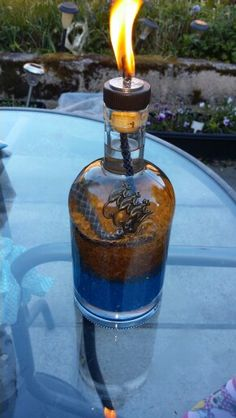 Citronella torch made from an old monkey shoulder whiskey bottle.
