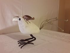 birds sculpture made of stone (white marble) and steel