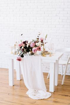 White + pink wedding reception decor - white reception table with pink centerpiece and gold candles {Color Theory Collective}