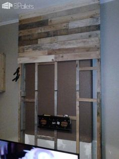 Wall from Pallet Wood / Mur En Bois De Palettes Wall from Pallet Wood / Mur En Bois De Palettes Pallet TV Stand & Rack Pallet Walls & Pallet Doors The post Wall from Pallet Wood / Mur En Bois De Palettes appeared first on Pallet Diy. Tv Stand Rack, Wall Tv Stand, Rack Tv, Tv Stand With Storage, Diy Tv Stand, Lp Storage, Record Storage, Wooden Pallet Wall, Pallet Door