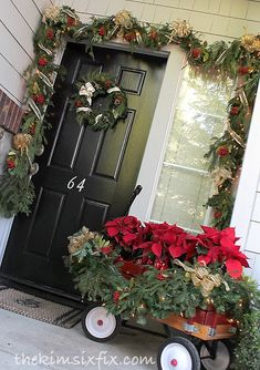 Radio flyer wagon full of poinsettias on the front porch