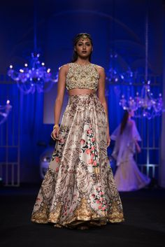 Indian crop top lehnga with floral print by Falguni & Shane Peacock. More here: http://www.indianweddingsite.com/bmw-india-bridal-fashion-week-ibfw-2014-falguni-shane-peacock-show/
