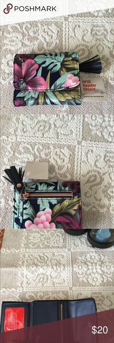 Flower Pattern Wallet W/RFID Reader Shield  NWOT Flower Pattern Wallet W/RFID Shield Reader Blue,mint green,Forrest green,pink,mauve and white colors Zipper for holding coins Approximately 4 X 3 1/4 Bags Wallets