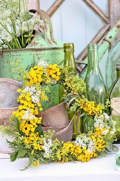This heart shaped wreath is teaming with bright yellow flowers...Seems to be the perfect shade for the green backdrop.