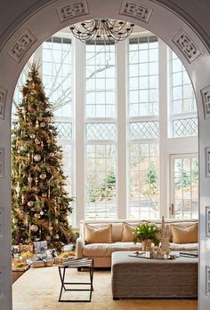dream house. tall ceilings, open and airy, lots of windows and light, and a tall christmas tree with pretty gifts wrapped in gold and silver.