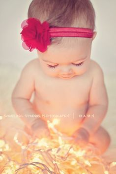 Beautiful baby photo ❤ this would be so cute if she was looking at the camera and holding or had the lights in her mouth