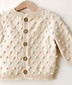 Baby Handmade Popcorn Cardigan - made with GOTS Certified Organic Cotton - handmade with. Baby Handmade Popcorn Cardigan - made with GOTS Certified Organic Cotton - handmade with love Knitted Baby Cardigan, Baby Pullover, Knitted Baby Clothes, Baby Boy Cardigan, Baby Clothes Patterns, Baby Knitting Patterns, Hand Knitting, Baby Outfits, Women Empowerment Project