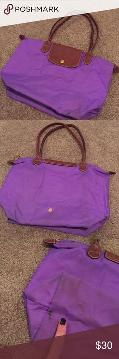 Longchamp Le Pliage Purple medium tote Loved but still with tons of life left! Grab this limited color (lilac purple) Longchamp Le Pliage medium bag! Folds up and is a wonderful travel bag as well as an every day bag. Extremely light weight and super roomy for all your everyday needs! Small laptop (like a MacBook Air) can fit inside! Smaller picked on the inside for your keys or card! Longchamp Bags Totes