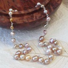 golden peach freshwater pearl necklace with sterling silver.