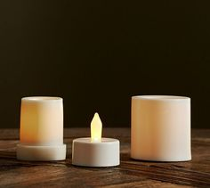 Pottery Barn Flameless Outdoor Tealight & Votive Candle. How lovely are these flameless candles lit? They may be small, but they still cast a gorgeous light with perfect ambiance. How would you decorate your yard with these?